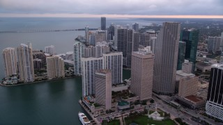 AX0022_051 - 5K stock footage aerial video of skyscrapers on the shore of Biscayne Bay in Downtown Miami at sunset, Florida