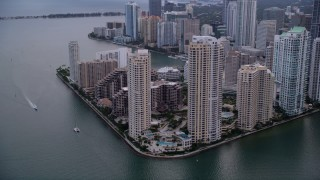 AX0022_052 - 5K stock footage aerial video of waterfront skyscrapers on Brickell Key in Downtown Miami at sunset, Florida