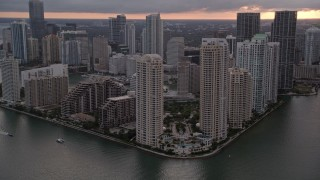 AX0022_052E - 5K stock footage aerial video of waterfront skyscrapers on Brickell Key in Downtown Miami at sunset, Florida