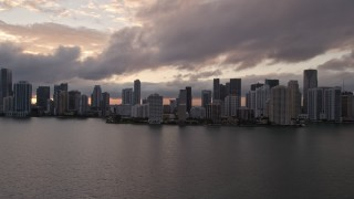 AX0022_054E - 5K stock footage aerial video of Downtown Miami skyline at sunset seen from Biscayne Bay, Florida