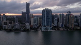 AX0022_057 - 5K stock footage aerial video approach skyscrapers and high-rise hotel in Downtown Miami at sunset, Florida