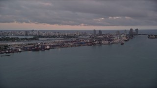 AX0022_060 - 5K stock footage aerial video of Port of Miami seen from Biscayne Bay at sunset in Florida
