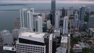 AX0022_067 - 5K stock footage aerial video of skyscrapers by the shore of the bay in Downtown Miami at sunset, Florida
