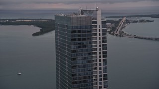AX0022_069E - 5K stock footage aerial video flyby the top of the Four Seasons Hotel tower at sunset in Downtown Miami, Florida