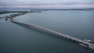 AX0022_071 - 5K stock footage aerial video approach bridge on the Rickenbacker Causeway at sunset, Florida