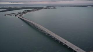AX0022_071E - 5K stock footage aerial video orbit bridge on the Rickenbacker Causeway at sunset, Florida