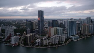 AX0022_079 - 5K stock footage aerial video flyby high-rise hotel and waterfront skyscrapers at sunset in Downtown Miami, Florida