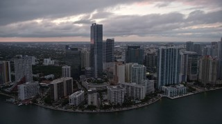 AX0022_079E - 5K stock footage aerial video flyby high-rise hotel and waterfront skyscrapers at sunset in Downtown Miami, Florida