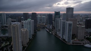 AX0022_083 - 5K stock footage aerial video of Miami River and riverfront skyscrapers at sunset in Downtown Miami, Florida