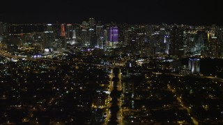 AX0023_005 - 5K stock footage aerial video fly Over SW 3rd Ave to approach Downtown Miami at night, Florida