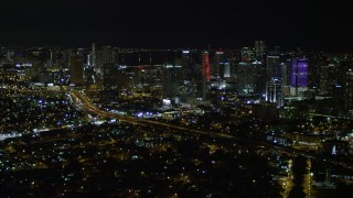 AX0023_006 - 5K stock footage aerial video approach the Downtown Miami skyline at night, Florida