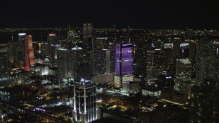AX0023_008 - 5K stock footage aerial video approach Brickell World Plaza at night in Downtown Miami, Florida