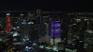 AX0023_008E - 5K stock footage aerial video approach Brickell World Plaza at night in Downtown Miami, Florida