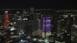 AX0023_009 - 5K stock footage aerial video of approaching Brickell World Plaza at night in Downtown Miami, Florida