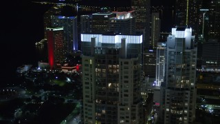 AX0023_025E - 5K stock footage aerial video of illuminated rooftops of Vizcayne towers at Night in Downtown Miami, Florida
