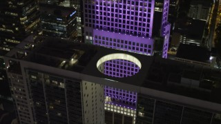 AX0023_029 - 5K stock footage aerial video of a bird's eye view of the 500 Brickell Rooftop at night in Downtown Miami, Florida