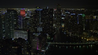 AX0023_035 - 5K stock footage aerial video of Brickell Key and Downtown Miami skyscrapers at nighttime, Florida