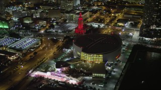 AX0023_044 - 5K stock footage aerial video orbiting the American Airlines Arena in Downtown Miami at night, Florida
