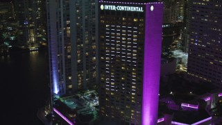 AX0023_047 - 5K stock footage aerial video orbit the InterContinental Miami Hotel at night in Downtown Miami, Florida