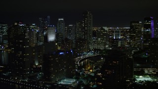 AX0023_049E - 5K stock footage aerial video flyby skyscrapers on Brickell Key in Downtown Miami at night, Florida