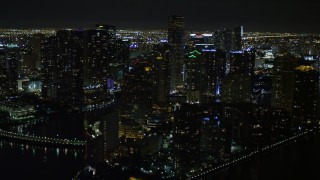 AX0023_055E - 5K stock footage aerial video flyby Brickell Key high-rises at night in Downtown Miami, Florida