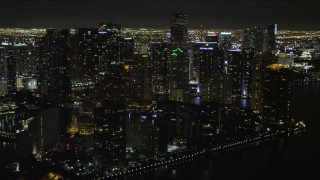 AX0023_056 - 5K stock footage aerial video of bayside skyscrapers on Brickell Key at night in Downtown Miami, Florida