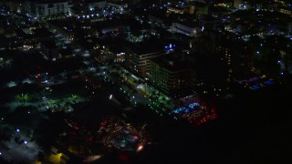 AX0023_069 - 5K stock footage aerial video of beachfront park and hotel at night in South Beach, Florida