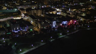 AX0023_071 - 5K stock footage aerial video of hotels and cafes with bright lights at night in South Beach, Florida