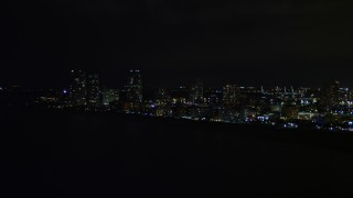 AX0023_074 - 5K stock footage aerial video of South Beach seen from the ocean at night in Florida