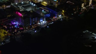 AX0023_076E - 5K stock footage aerial video of passing by hotels and Ocean Drive at night in South Beach, Florida
