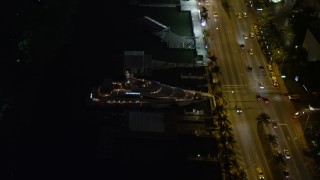 AX0023_098E - 5K stock footage aerial video orbit Fontainebleau Miami Beach Resort Hotel and yacht at night, Florida