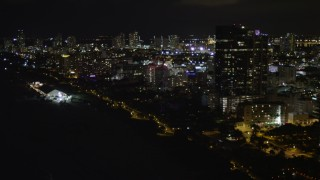 AX0023_106 - 5K stock footage aerial video flyby beachfront hotels at night in Miami Beach, Florida