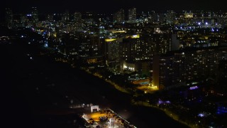 AX0023_106E - 5K stock footage aerial video flyby beachfront hotels at night in Miami Beach, Florida