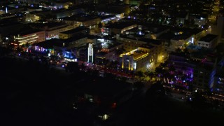 AX0023_110E - 5K stock footage aerial video of row of hotels on Ocean Drive at night in South Beach, Florida