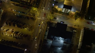 AX0023_117 - 5K stock footage aerial video bird's eye view of a street through South Beach at night, Florida