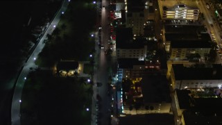 AX0023_120 - 5K stock footage aerial video of a bird's eye view of Ocean Drive through South Beach at night, Florida