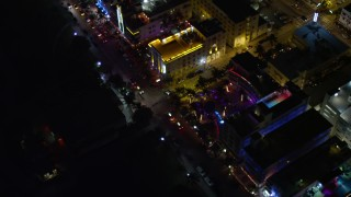 AX0023_120E - 5K stock footage aerial video of a bird's eye view of Ocean Drive's hotels in South Beach at night, Florida