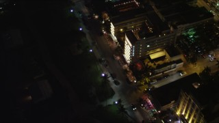 AX0023_121 - 5K stock footage aerial video bird's eye view of hotels and lights on Ocean Drive at night in South Beach, Florida