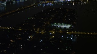 AX0023_134 - 5K stock footage aerial video of mansions and tennis courts on Palm Island at night in Florida