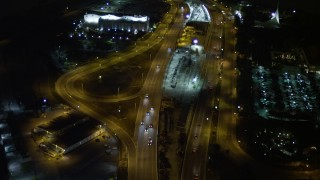 AX0023_136 - 5K stock footage aerial video fly over traffic on the MacArthur Causeway through Watson Island at night, Florida