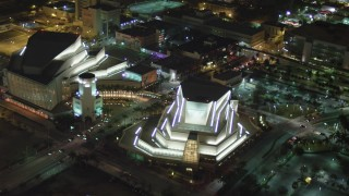 AX0023_140 - 5K stock footage aerial video approach the Adrienne Arsht Center for the Performing Arts in Downtown Miami at night, Florida