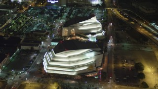 AX0023_143 - 5K stock footage aerial video of reverse view of the Adrienne Arsht Center for the Performing Arts at night in Downtown Miami, Florida