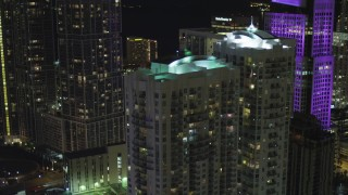 AX0023_146 - 5K stock footage aerial video flyby Brickell on the River Towers at night in Downtown Miami, Florida
