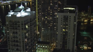 AX0023_147 - 5K stock footage aerial video flyby Brickell on the River and 500 Brickell at night in Downtown Miami, Florida
