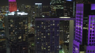 AX0023_148 - 5K stock footage aerial video flyby 500 Brickell to reveal Brickell World Plaza at night in Downtown Miami, Florida