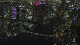 AX0023_180 - 5K stock footage aerial video of Downtown Miami skyscrapers near Brickell Key Drive Bridge at night in Florida