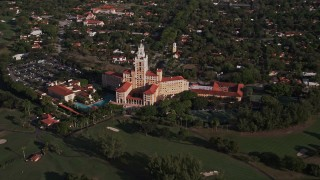 AX0024_014 - 5K stock footage aerial video of orbiting the Coral Gables Biltmore Hotel, Coral Gables, Florida