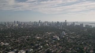 AX0024_025E - 5K stock footage aerial video fly over neighborhoods, reveal Downtown Miami skyline, Coconut Grove, Florida