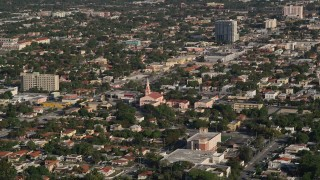 AX0024_027 - 5K stock footage aerial video of flying by a church and homes in Coral Way, Florida