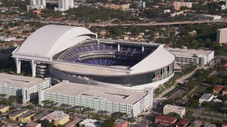 AX0024_029 - 5K stock footage aerial video of flying by Marlins Park Stadium, Miami, Florida